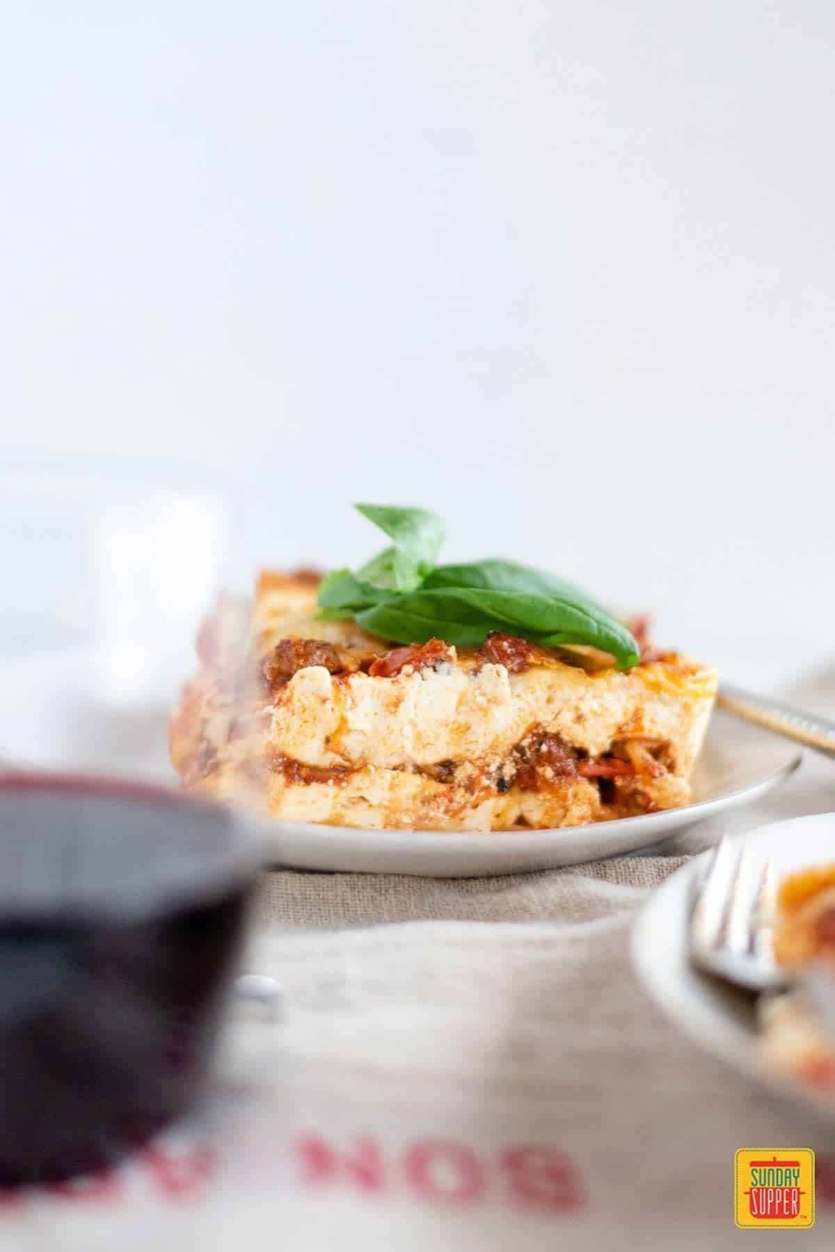 Lasagna for two and a glass of red wine
