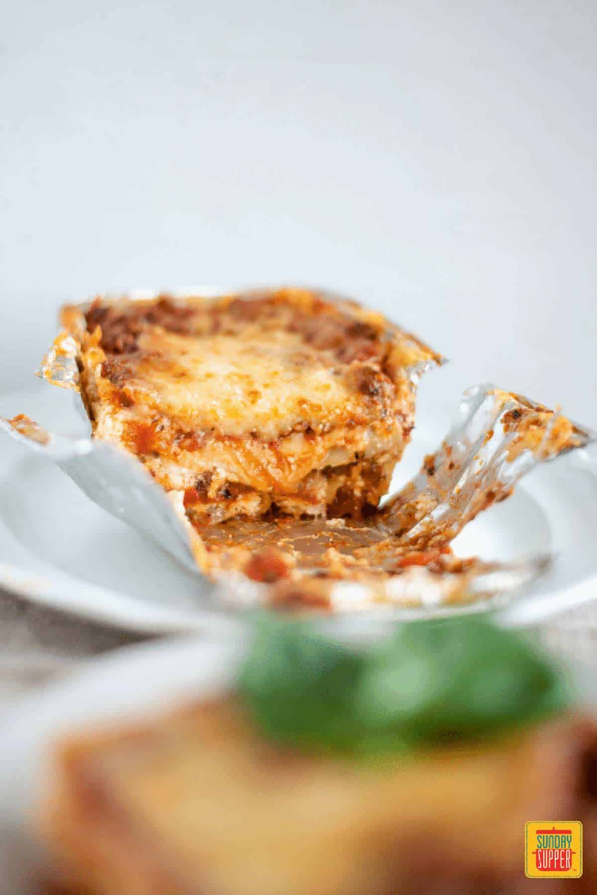 Lasagna for two cut in half in the baking tin