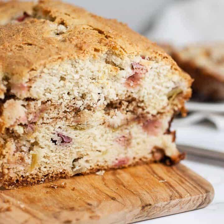 Rhubarb bread: rhubarb bread served on a wooden bread paddle