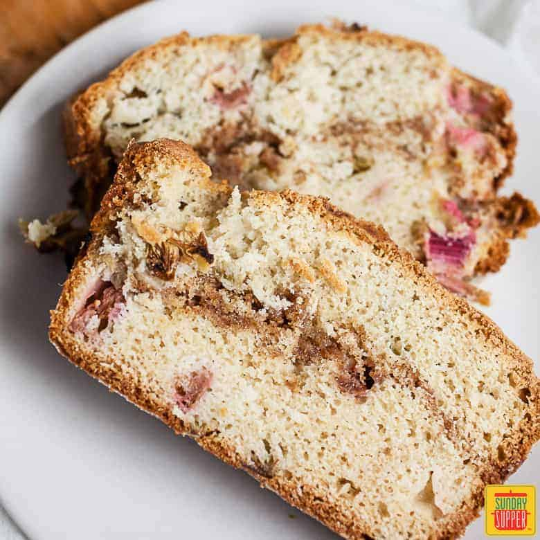 Rhubarb bread: two slices of rhubarb bread served on a white plate