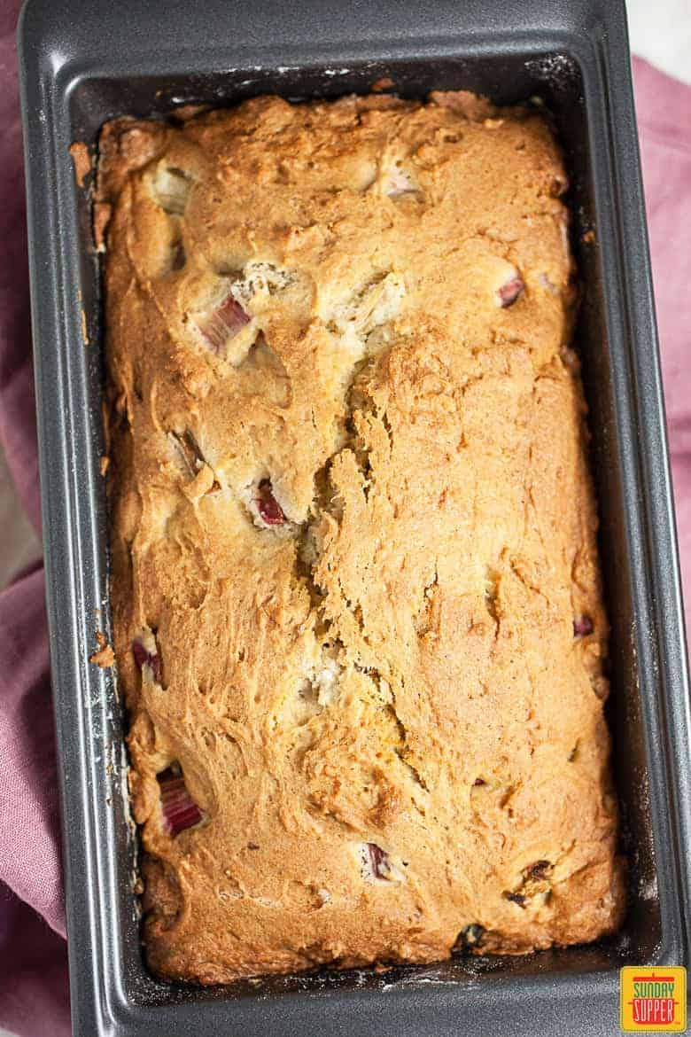 Rhubarb bread fresh out of the oven in a baking pan