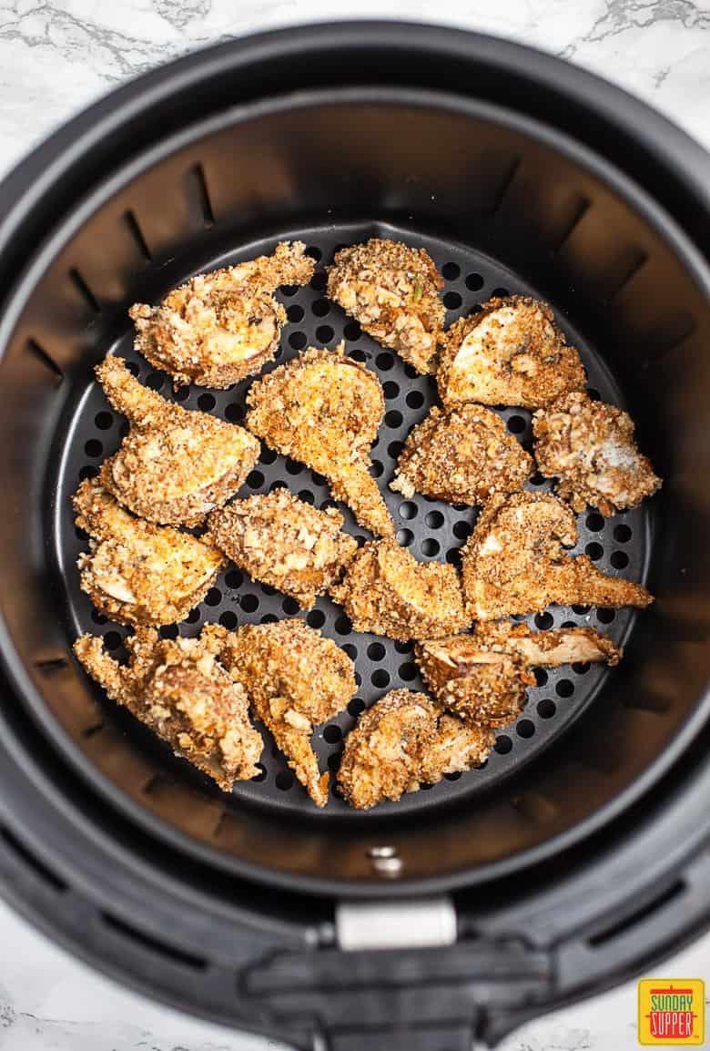 Air fryer mushrooms in an air fryer, freshly fried