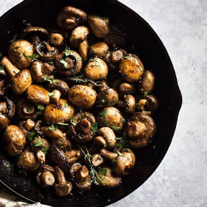Button Mushrooms Recipe served in a cast iron skillet