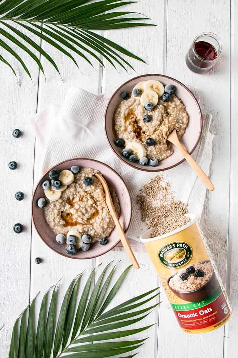 Instant pot breakfasts: Instant pot maple oats with blueberries in two bowls by My Kitchen Love