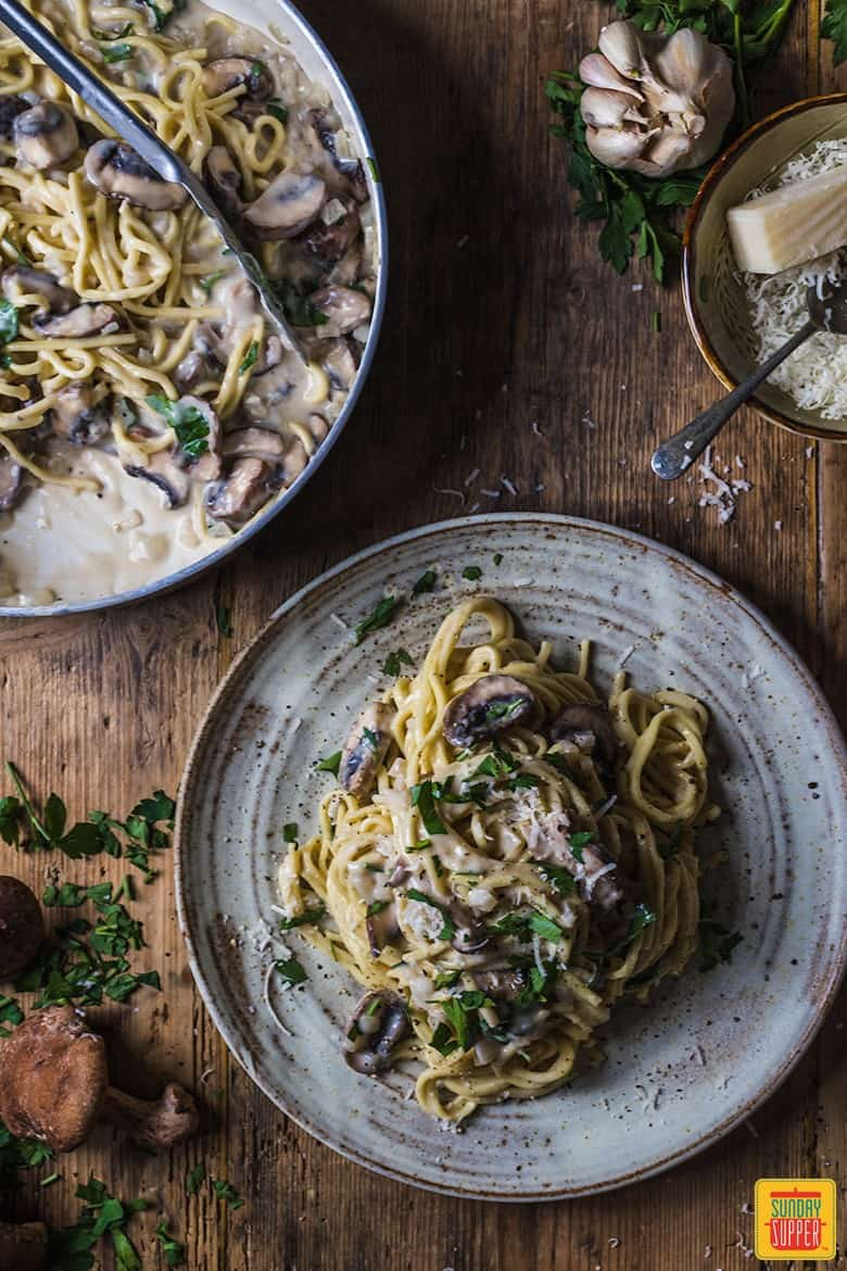 Creamy mushroom pasta on ceramic plates ready to enjoy
