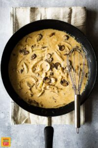 sauce in pan for chicken breast and mushroom recipe
