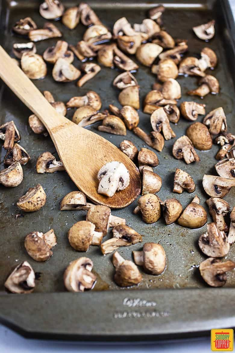 Roasting the button mushrooms for the veggie burger patties