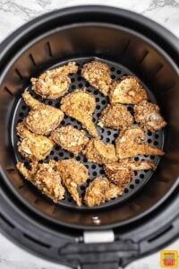 Air fryer mushrooms in the air fryer basket after frying