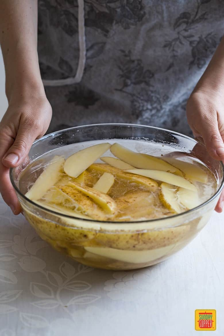 potato wedges soaked in cold water to remove starch