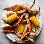 Boiled Crab Legs Recipe with garlic butter and corn on the cob