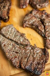 Grilled chuck steaks on a cutting board