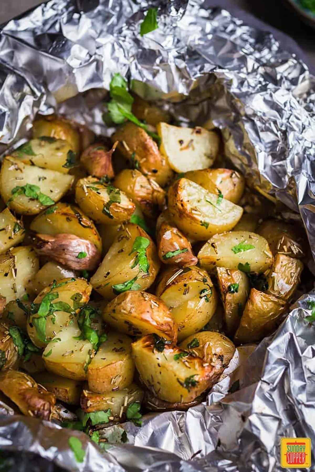 Close up of foil pack potatoes in the foil