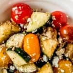 Save Tomato Cucumber and Feta Salad on Pinterest for later!
