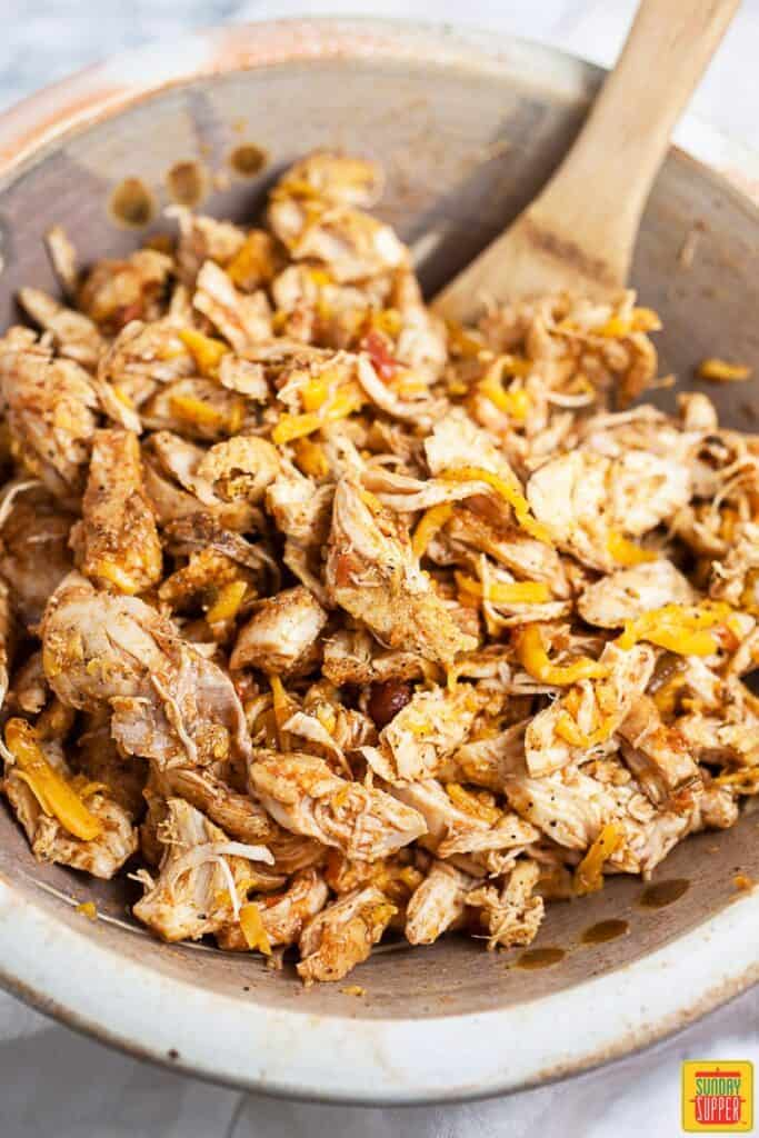 Shredded Chicken and Cheese In Mixing Bowl