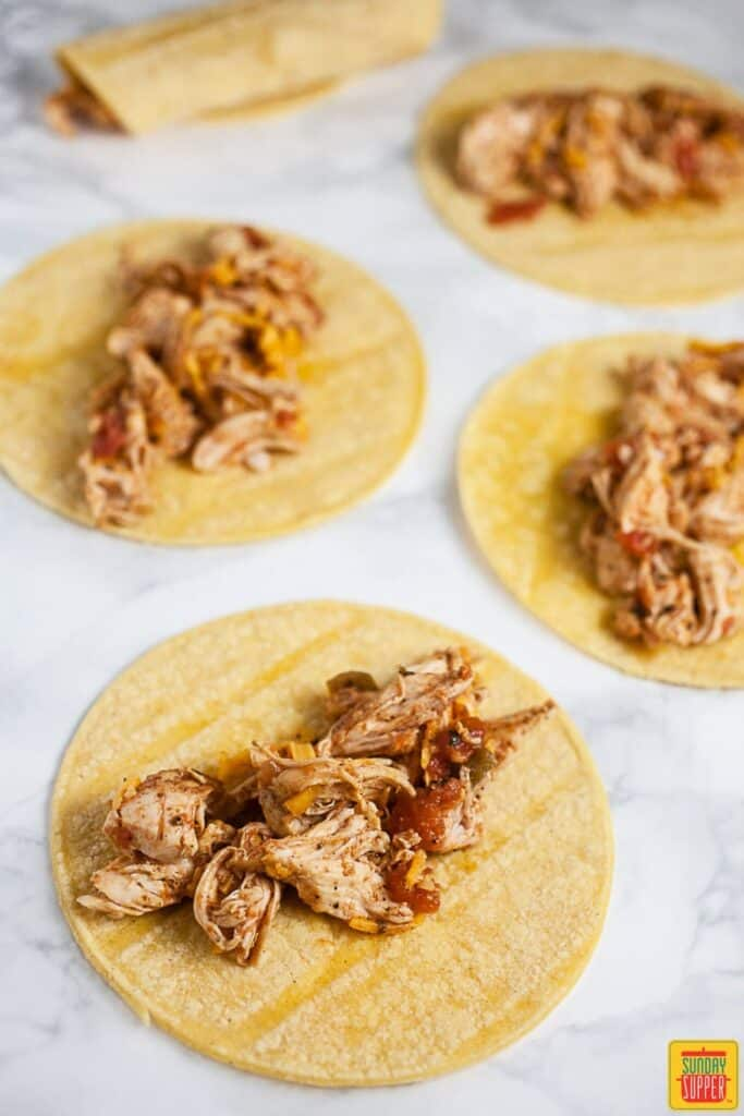 Shredded Chicken Added To Corn Tortillas and Rolled Tightly