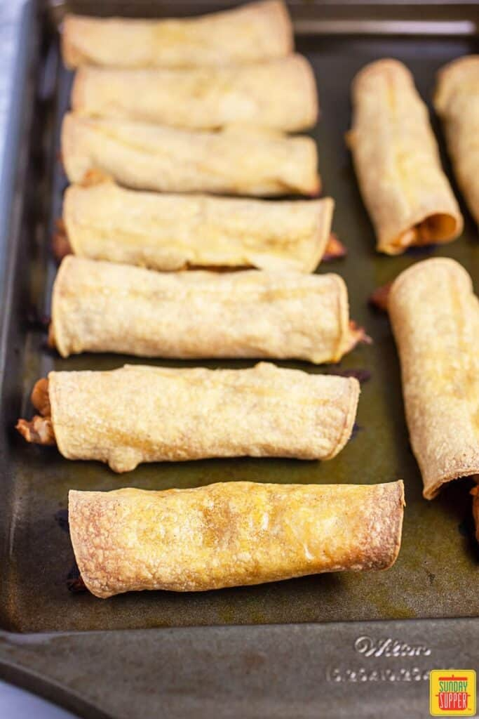 Baked Chicken Taquitos On Baking Sheet