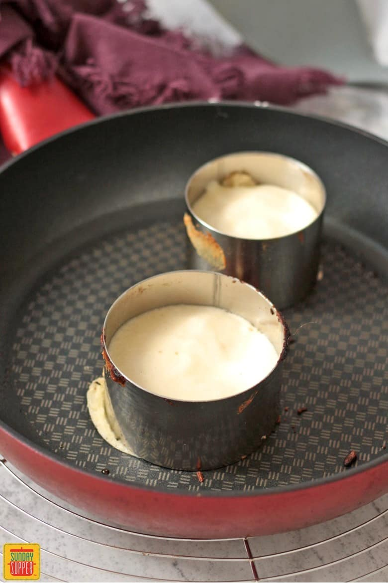 Cooking the pancakes in pastry rings