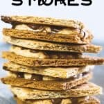 air fryer s'mores pin image - s'mores stacked on top of each other on a blue surface