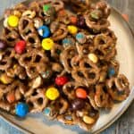 Close up of chocolate peanut butter pretzels snack mix on a plate