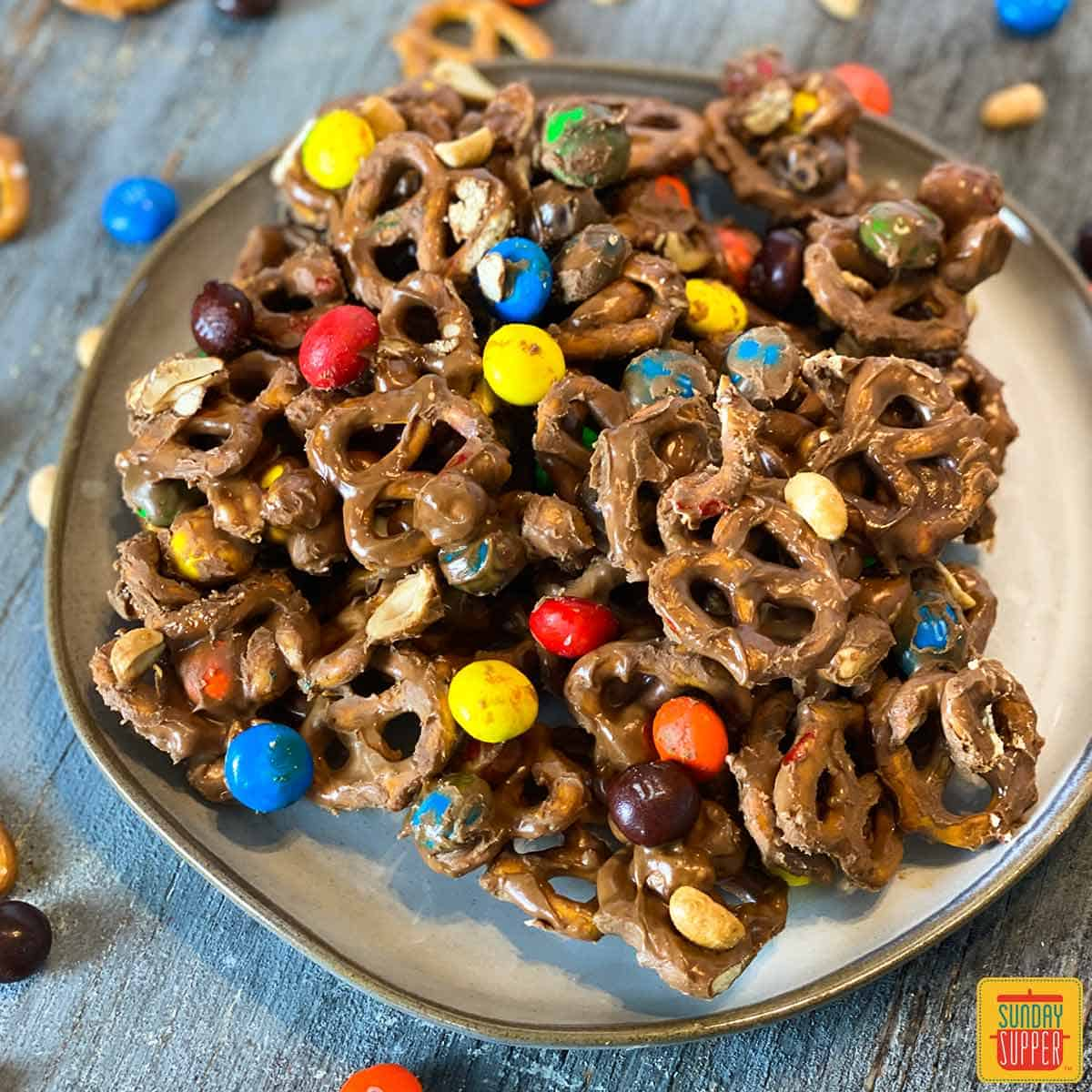Chocolate peanut butter pretzels snack mix on a plate