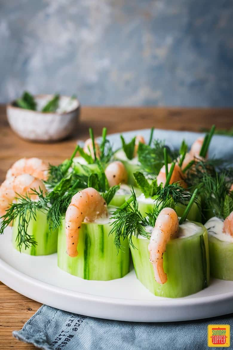 cucumber canapes with shrimp on white serving plate