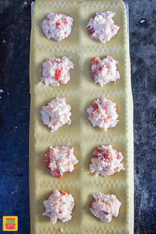 adding lobster filling to ravioli