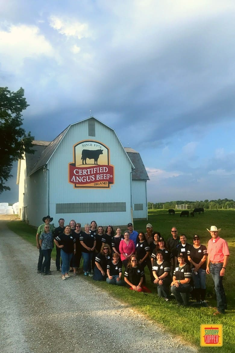 group photo from the Certified Angus Beef® brand trip at the Chippewa Valley Angus Farm