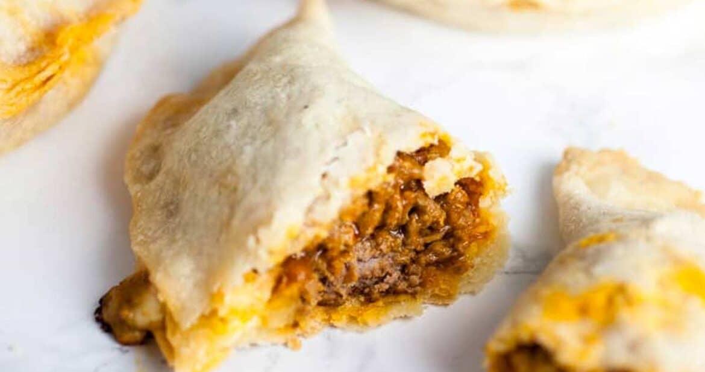 Puerto Rican Baked Empanadas open to show filling