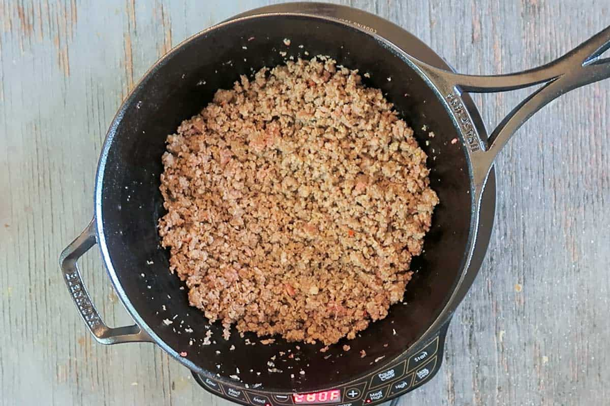 Browned sausage in skillet for sausage gravy biscuits
