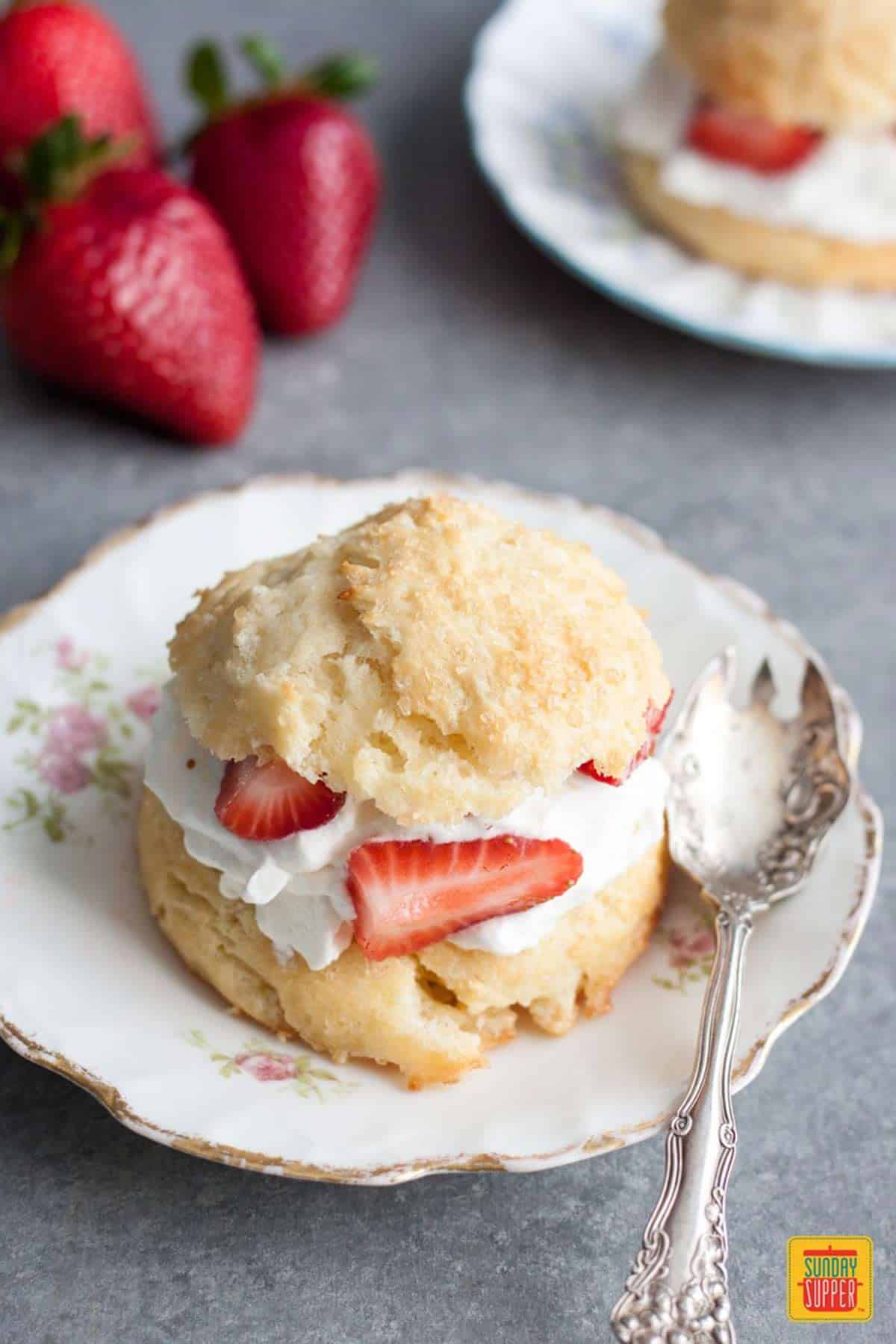 strawberry shortcake biscuit on a plate with a spoon