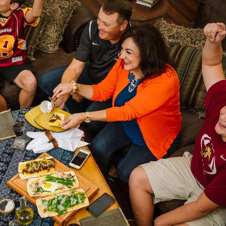 Isabel and her family enjoying football party food on game day