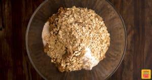 Oats, flour, salt, sugar, and butter in a glass bowl