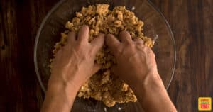 Crumbing the apple streusel topping with hands