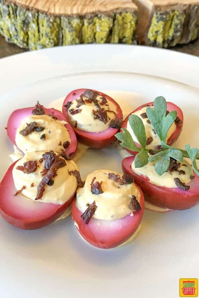 Beet-Dyed Deviled Eggs with Crispy Beef Bacon Bits