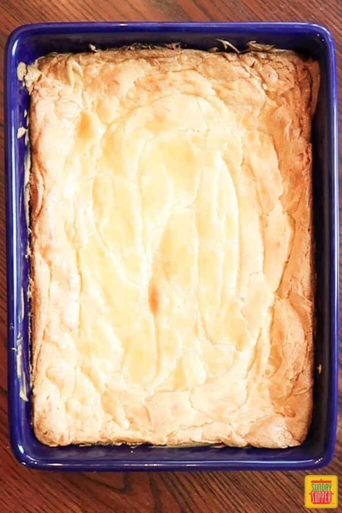 Freshly baked ooey gooey butter cake in baking dish