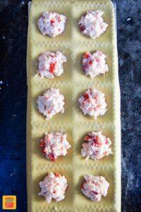 Ravioli lobster filling on sheets of pasta dough
