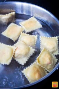 Lobster raviolis in boiling water