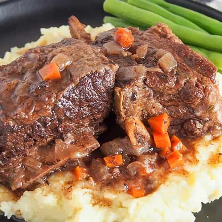slow cooker short ribs on black plate