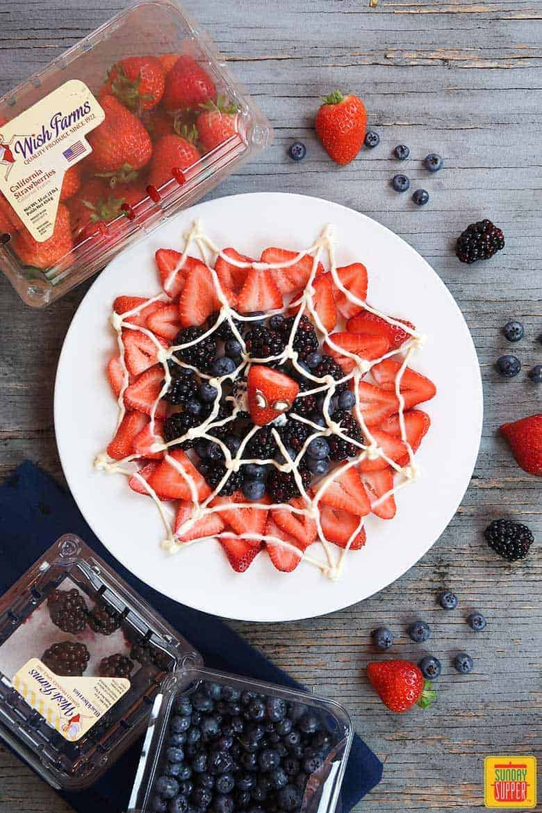 spider-man web berry dessert on white plate ready to enjoy