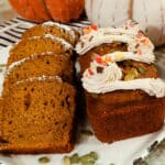 Starbucks pumpkin bread mini loaf on a white platter with slices