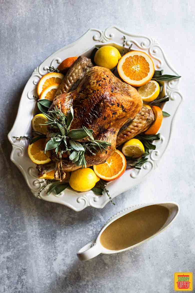 Best Thanksgiving Turkey Recipe with gravy in gravy boat