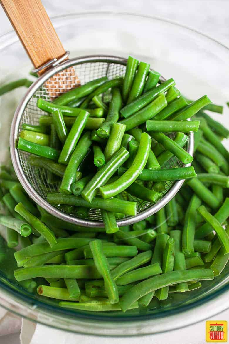 Blanched Green Beans In Bowl Of Ice Water