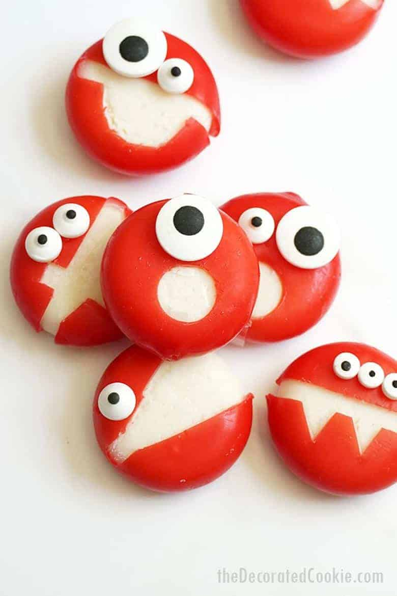 Babybel Halloween snacks on a white surface from The Decorated Cookie