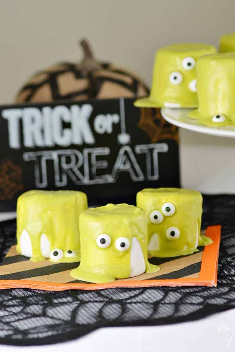 Halloween monster marshmallows on a Halloween theme napkin from Finding Zest