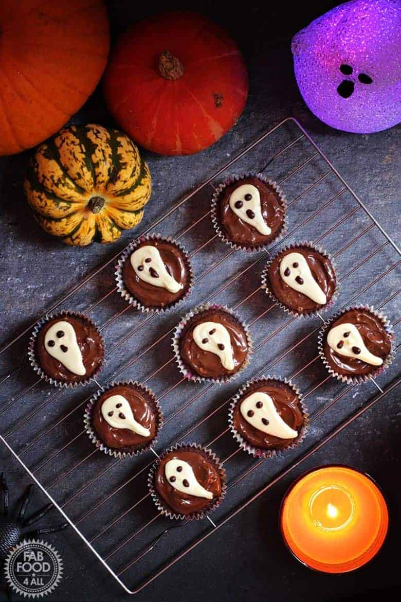 Halloween ghost cupcakes on a baking rack from Fab Food 4 All
