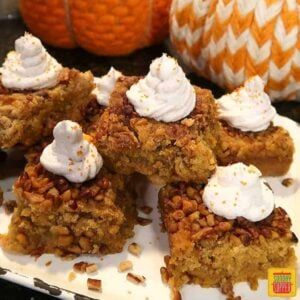 Pumpkin crunch cake squares on a white platter