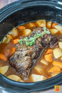 Slow cooker chuck roast in the slow cooker after cooking