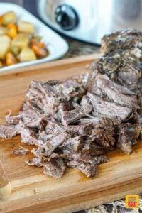 Shredded chuck roast on a cutting board