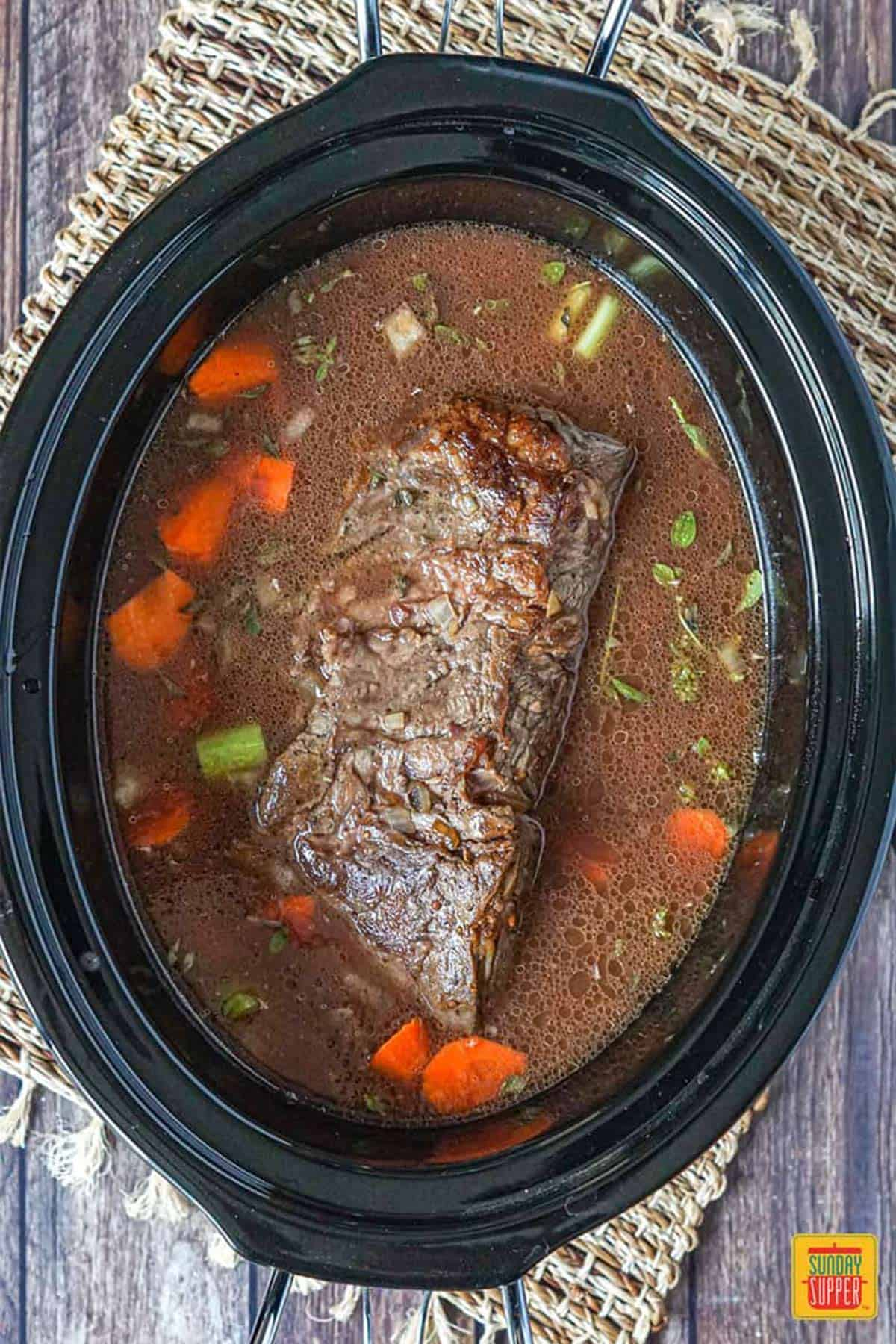 Chuck roast in slow cooker with vegetables