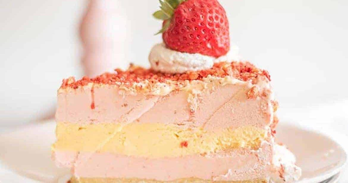 Single slice of strawberry shortcake ice cream cake on white plate
